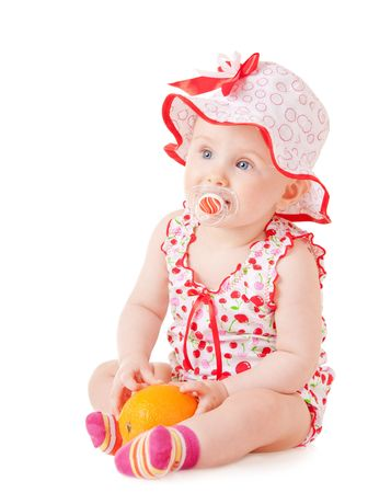 a baby with orange on white background