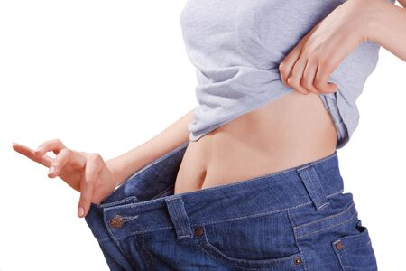 Slim woman stomack in large jeans