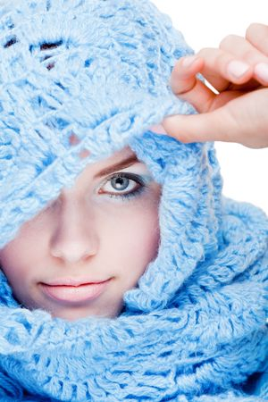 Young pretty girl in blue wool scarf photo