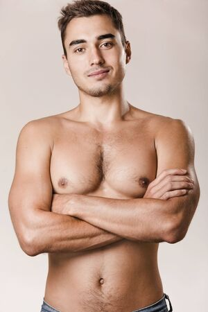 Young handsome man with bare torso