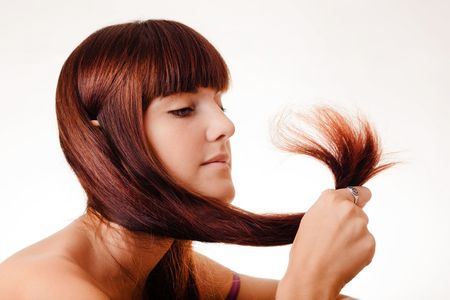 Young girl holding her hair tips Stock Photo