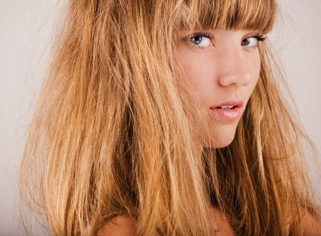 disarray: Young pretty girl with fair hair portrait Stock Photo