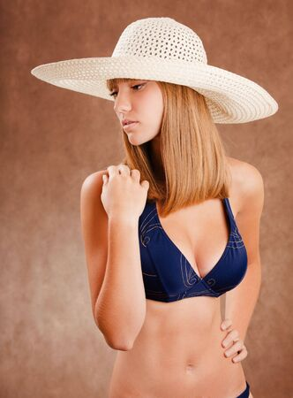 Young pretty girl in a straw hat photo