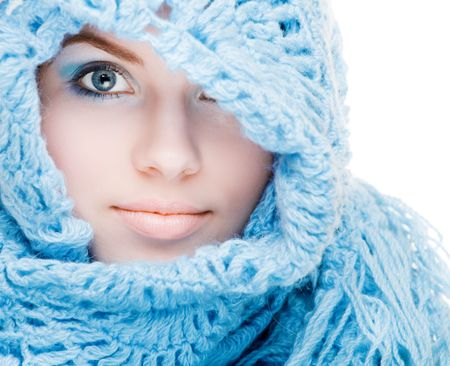 Young pretty girl in a blue scarf photo