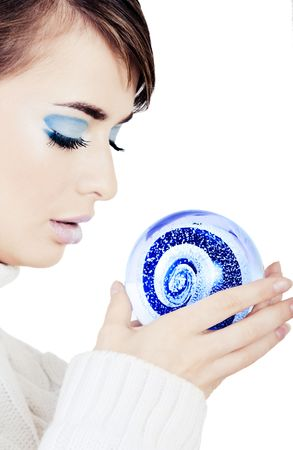 eyelids: Girl holding a crystal ball on white background Stock Photo