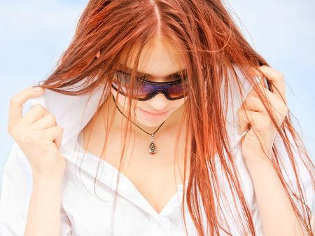 Young pretty girl with long red hair photo