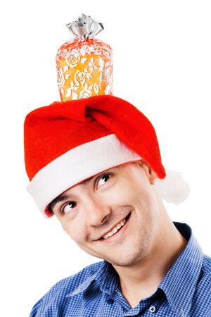 Young smiling man in Santa hat photo