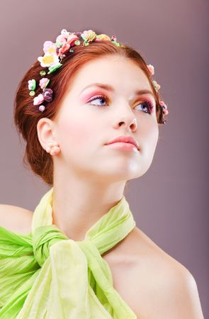 Young girl with a green scarf portrait Stock Photo