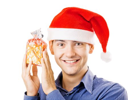 Young man in santa hat holding a present photo