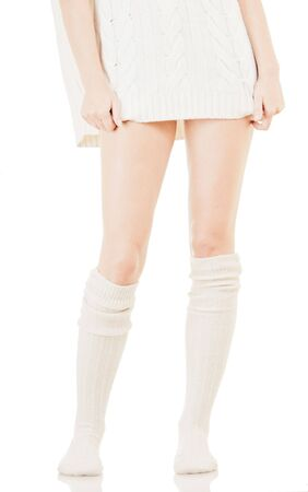 Woman legs in white stockings on white background