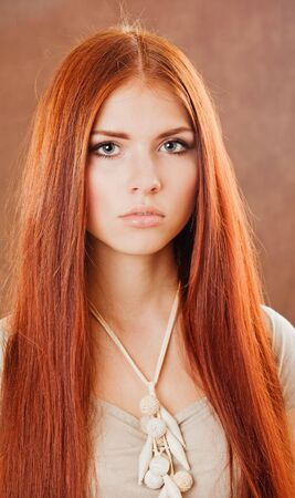 Young pretty girl with red hair portrait photo