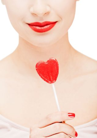 Girl with red lips holding a lollipop