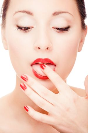 Young pretty girl licking her finger portrait Stock Photo