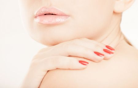 Woman face with lips and hand close-up