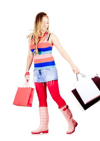 Young pretty girl with shopping bags photo