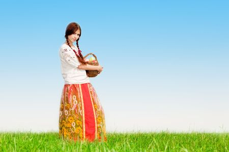 Young pretty girl in green grass field photo