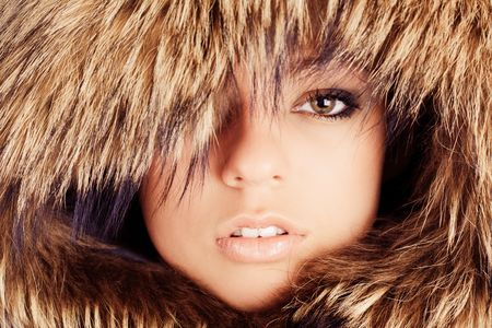 Young pretty girl in fur hood portrait