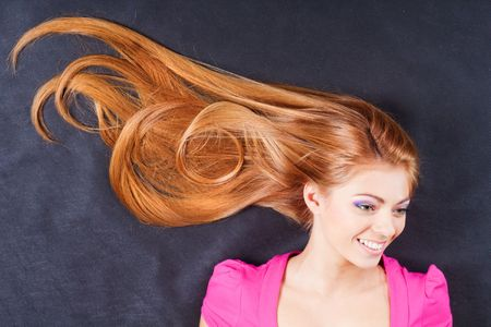 Young pretty smiling girl with smiling hair Stock Photo