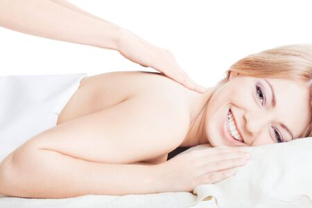Young pretty smiling girl is having massage