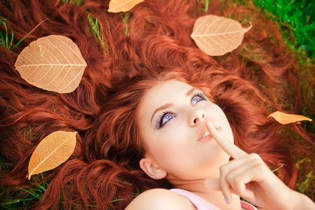 Young pretty girl lying on grass Stock Photo