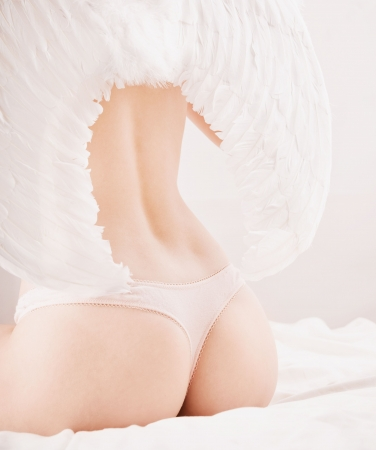 Woman sitting in white angel wings photo
