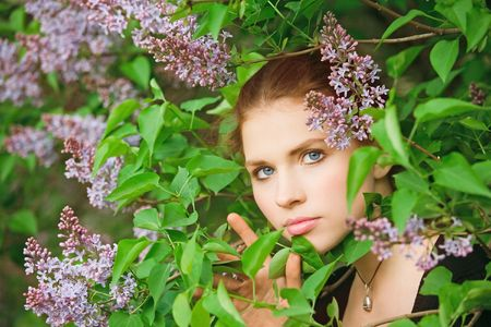 Young pretty girl in the garden portrait photo