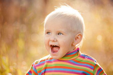 Small pretty girl in a striped sweater portrait Stock Photo