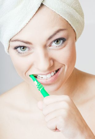 bother: Young pretty girl cleaning teeth