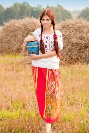 Young pretty girl in ethnic dress photo