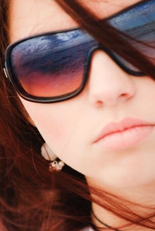 Young girl in sunglasses with long hair portrait photo