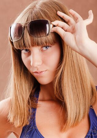 Young pretty girl with sunglasses portrait photo