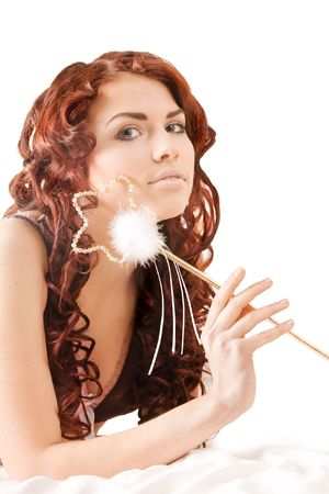 red head girl: Young pretty girl holding a magic wand