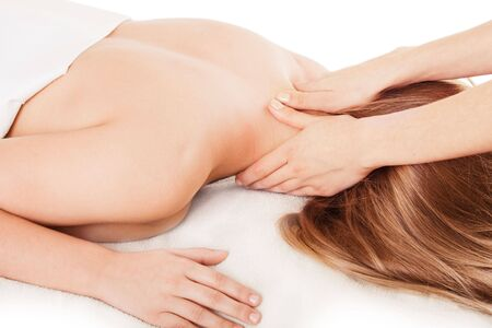 Woman lying face down is having massage Stock Photo