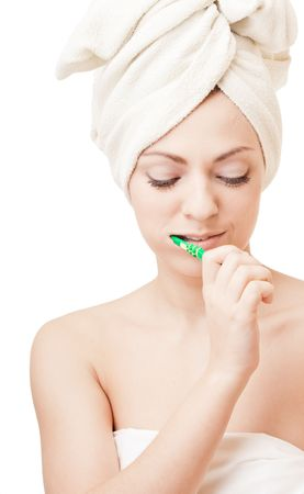 Young pretty girl cleaning teeth on white background photo