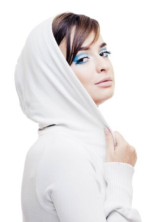 Young pretty girl in a white hood portrait
