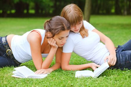 Two young pretty student girls in white t-shirt photo