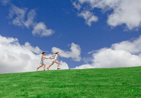 Two young girls running on green field photo