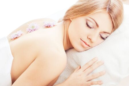 Young pretty girl lying with closed eyes photo