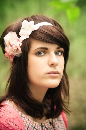 Young pretty girl with dark hair outdoor portrait