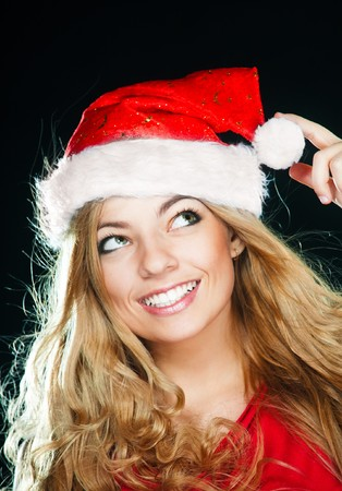 Young pretty girl with long hair in Santa hat