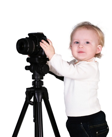 A child with a camera in the studio photo