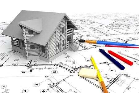 Wooden house on the drawings with stationery photo