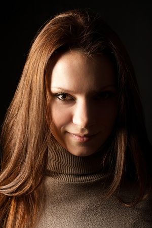 fas: portrait of a young girl in fas on a black background  Stock Photo