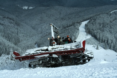 Snowcat on ski slopes photo