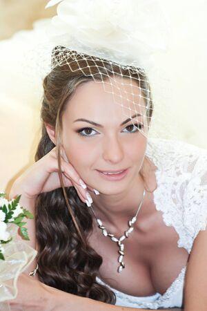 Portrait laughing bride with bouquet photo