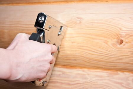 construction stapler in worker hands Stock Photo - 18824216