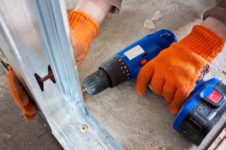 working turns drywall screwdriver Stock Photo