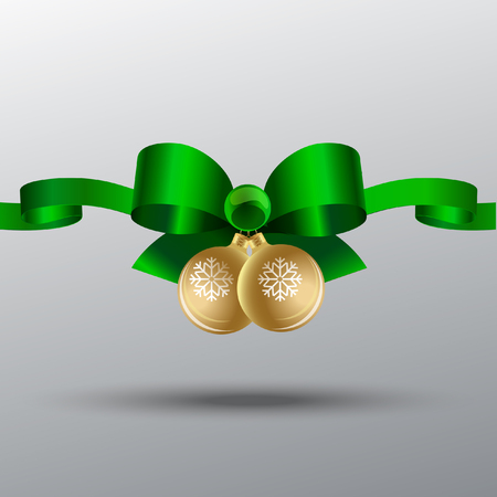 New green silk bow with ribbons and Christmas balls with snowflakes