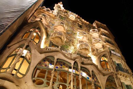 The famous Casa Batllo in Barcelona, Spain, was created by Antoni Gaudí in 1904 for the industrialist Josep Batllo. Long exposure picture taken at night. photo