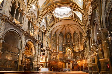 Basilica at the Montserrat Monastery, a spectacularly beautiful Benedictine Abbey high up in the mountains near Barcelona, Catalonia, Spain. Stock Photo